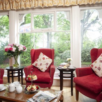 red chairs with floral pillows at Belmont Castle Care Home Bedhampton