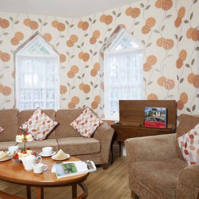Floral pillows and colourful wallpaper at Belmont Castle Care Home Bedhampton